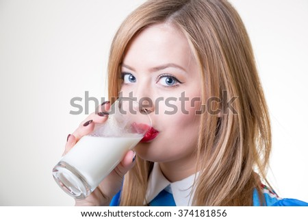 pretty girl drinking milk from glass - stock photo