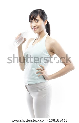 pretty girl drinking water from bottle - stock photo