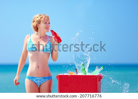 pretty girl drinks fresh beverages on beach - stock photo