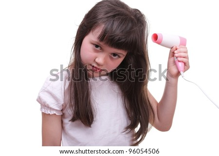 Pretty girl drying her hair hairdryer isolated on white - stock photo