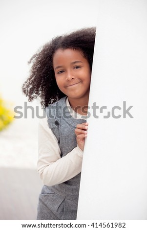 Pretty girl eight years old with beautiful afro hair  - stock photo