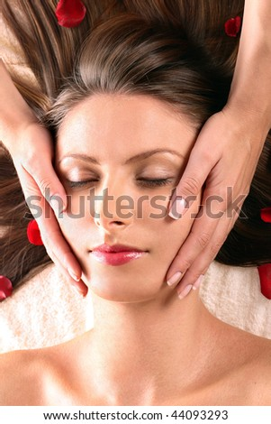 Pretty girl getting head massage