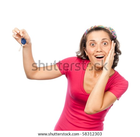Pretty girl happy with car keys - stock photo