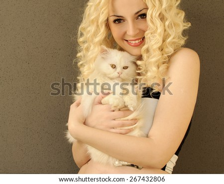 Pretty girl holding a cat - stock photo