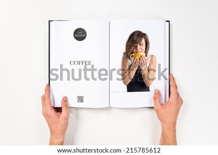 Pretty girl holding a cup of coffee printed on book - stock photo