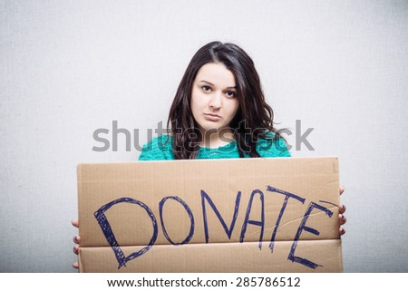 Pretty girl holding a sign donate
