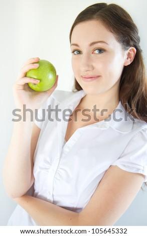 Pretty girl holding an apple - stock photo