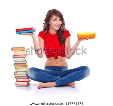 Pretty girl holding colorful books in both hands over white background - stock photo