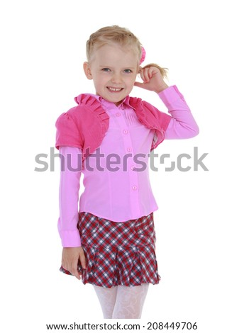 Pretty girl holding his hair.kindergarten, the concept of childhood and joy, teens - stock photo