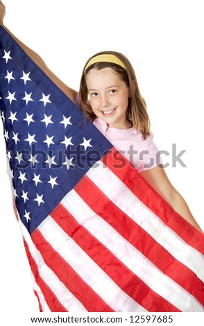 Pretty girl holding the American Flag with a big smile - stock photo