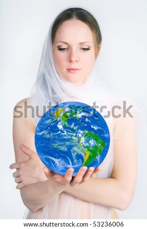 pretty girl holding the planet in the hands