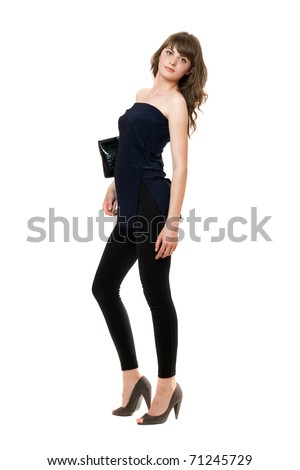 Pretty girl in a black leggings. Isolated on white