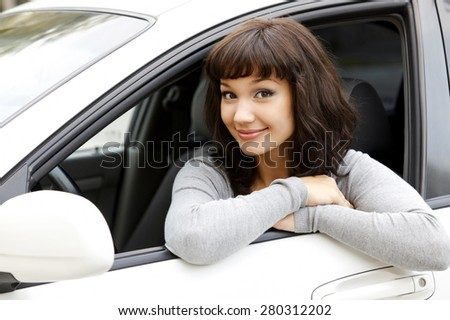Pretty girl in a car - stock photo