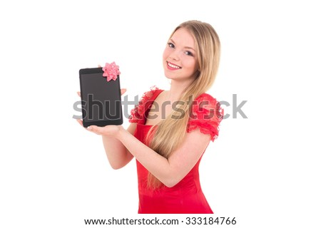 Pretty girl in a santa hat on new year holding tablet computer touch pad gadget with black screen and bow  - stock photo