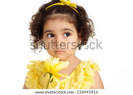 pretty girl in a yellow dress posing on a white background - stock photo