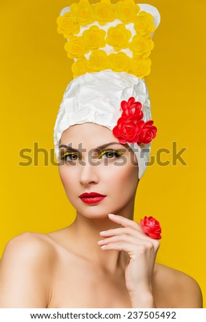 Pretty girl in headdress decorated with yellow and red roses  - stock photo