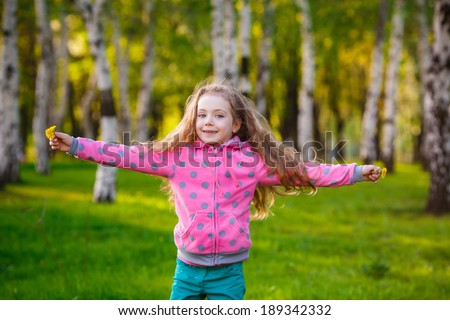 Pretty girl in park. Happy girl running in the park. Wind blows hair.   summer - stock photo