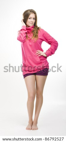 Pretty girl in pink sweater and short panties - stock photo