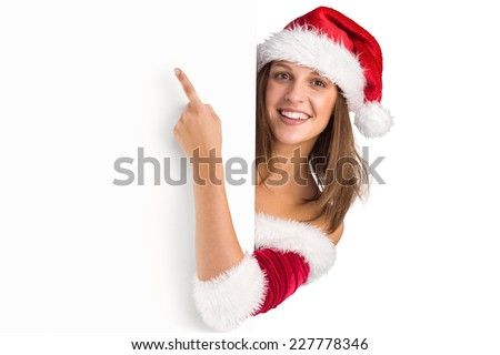 Pretty girl in santa costume showing card on white background - stock photo