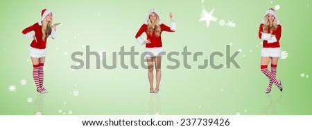 Pretty girl in santa outfit blowing against green vignette - stock photo