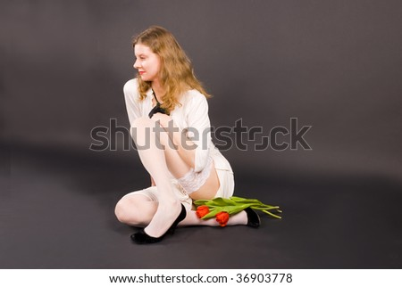 Pretty girl is a white dress and stocking - stock photo