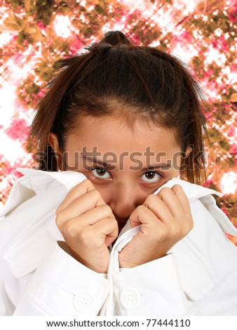 Pretty Girl Looking Shy With Sparkling Flowers Background - stock photo