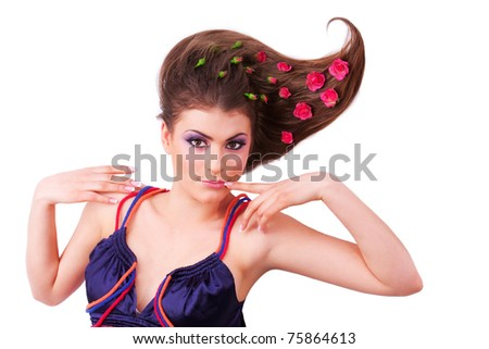 Pretty girl lying with flowers-roses in her hair