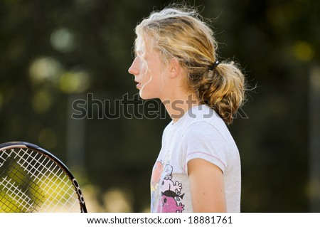 pretty girl playing tennis - stock photo