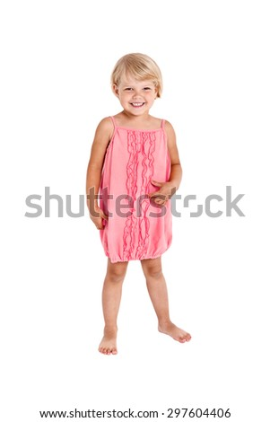 Pretty girl posing for the camera, in a pink short dress isolated on white background - stock photo