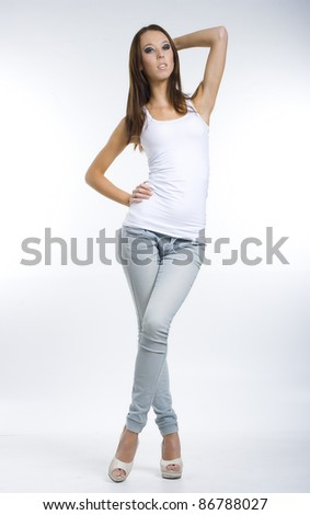 Pretty girl posing in jeans and a white top - stock photo