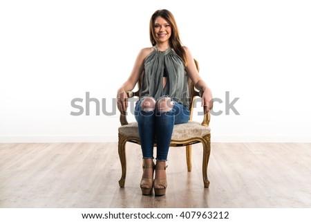 Pretty girl posing in studio - stock photo