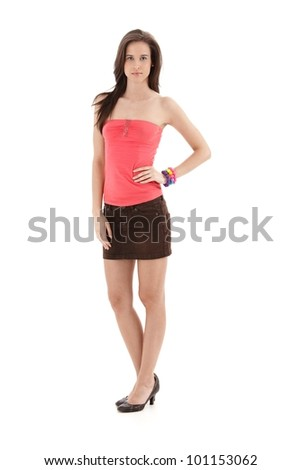 Pretty girl posing in studio in trendy summer clothes mini skirt and high heels, isolated on white, full length.   .