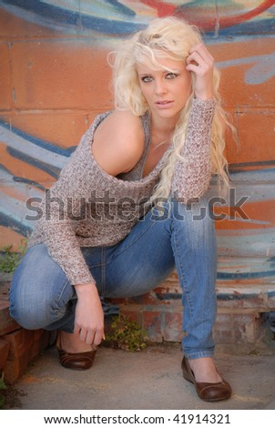 Pretty Girl Posing with Grafitti Wall Backgound - stock photo