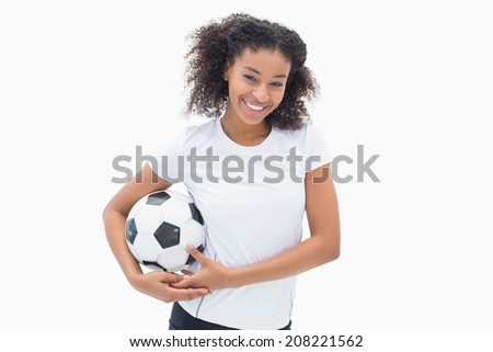 Pretty girl posing with her football on white background - stock photo