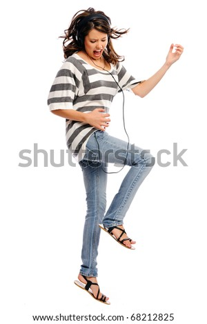 Pretty girl pretends to be a rock star and playing an air guitar - stock photo