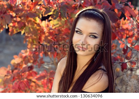 Pretty girl relaxing outdoor, beautiful teenager on nature background - stock photo