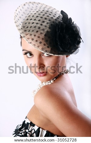 Pretty girl's portrait with a vintage hat - stock photo
