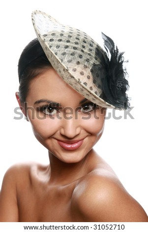 Pretty girl's portrait with a vintage hat isolated on white - stock photo