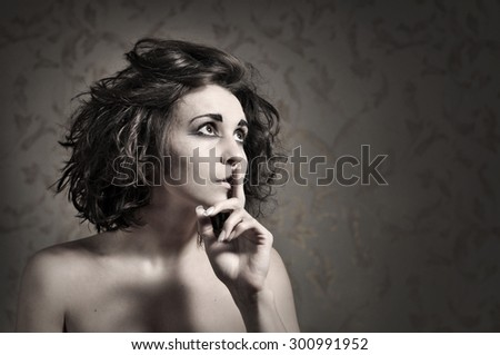 Pretty girl saying hush, be quiet - stock photo