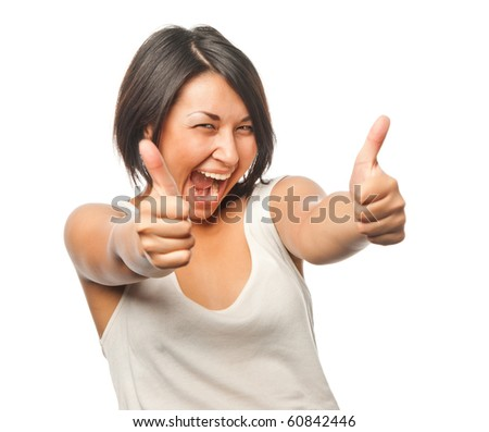 Pretty girl shows a thumbs up sign - stock photo
