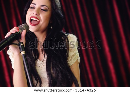 pretty girl singing at the revelry party - stock photo