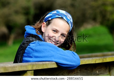 pretty girl smiling outdoors - stock photo