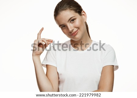 Pretty girl snapping fingers / Gorgeous girl in plain white T-shirt. Mixed race Latina Caucasian young woman gesticulating - isolated on white background.  - stock photo