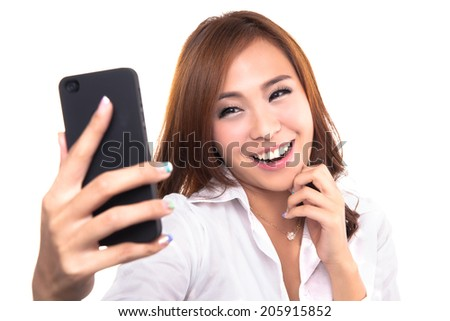 Pretty girl take a self portrait with her smart phone. Asian girl selfie, isolated on white background. - stock photo