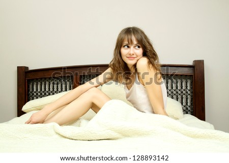 Pretty girl wakes up in bed