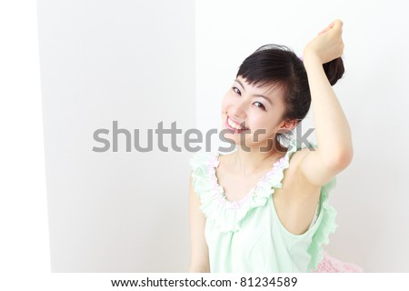 pretty girl waking up and stretching - stock photo