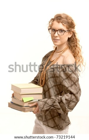 Pretty girl wearing glasses with books, studying for exame.? - stock photo