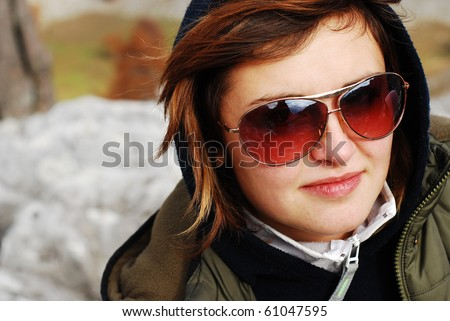 pretty girl wearing sunglasses - stock photo