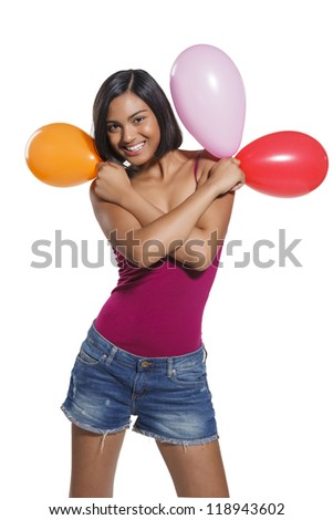 Pretty girl with a colored balloons during a party - stock photo