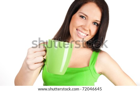 pretty girl with a green cup  on a white background - stock photo